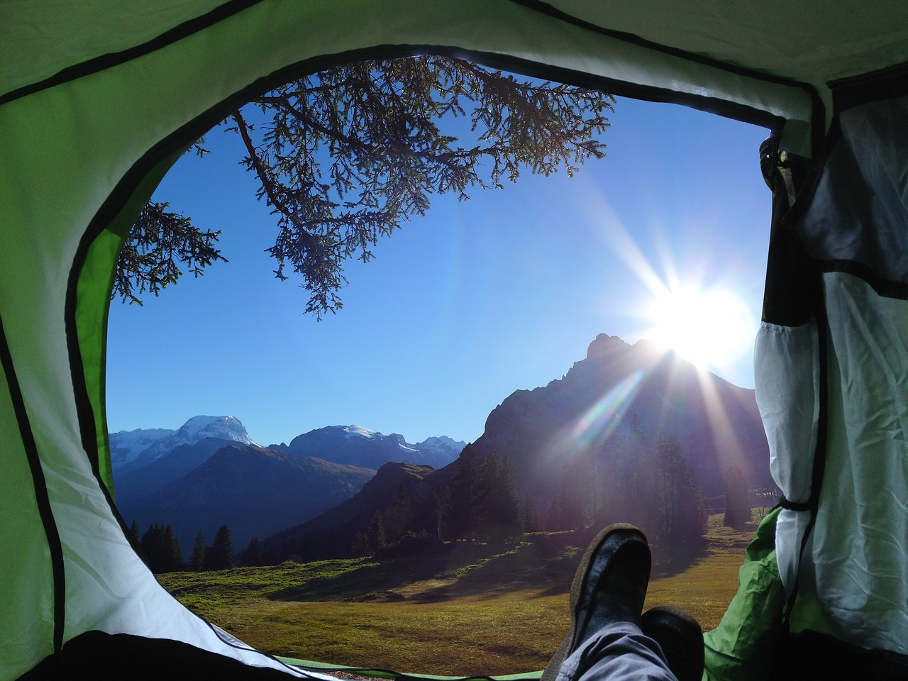view of the mountains from a tent