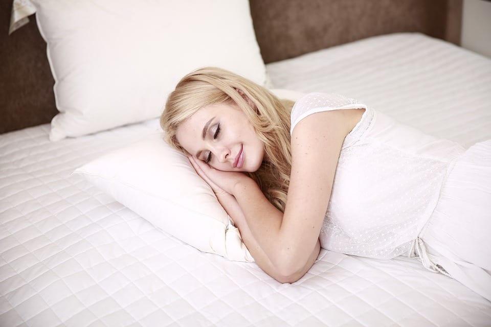 woman sleeping in a hotel room