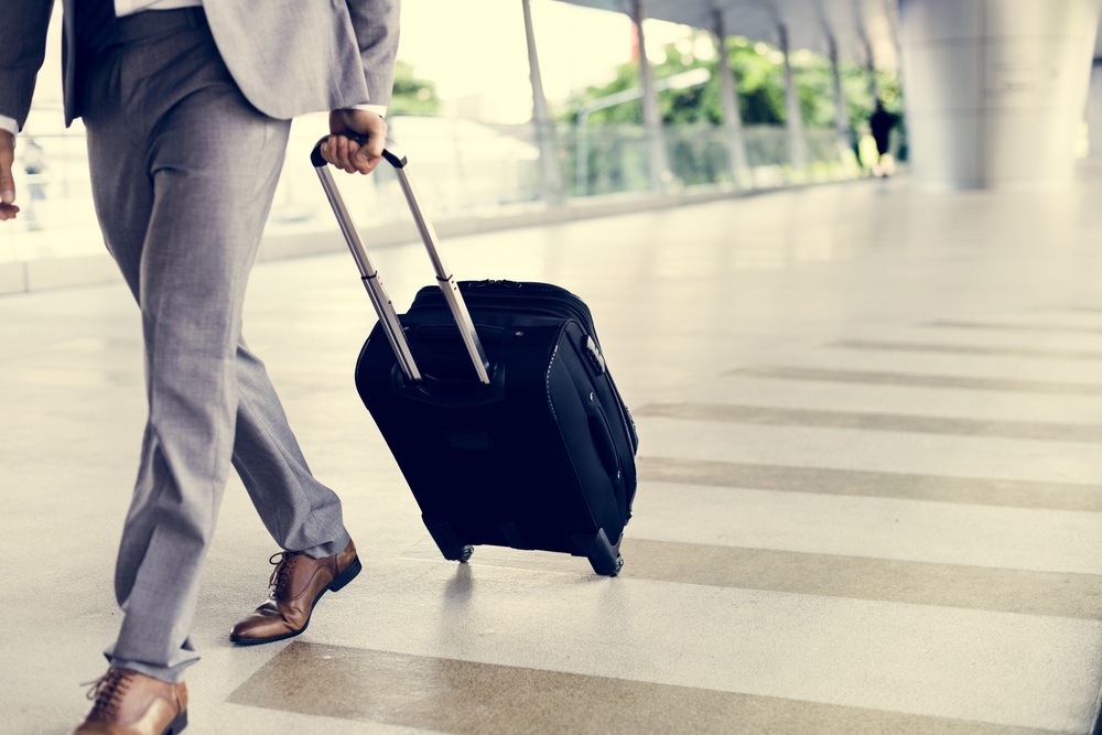 packing hacks for business travelers businessman with luggage