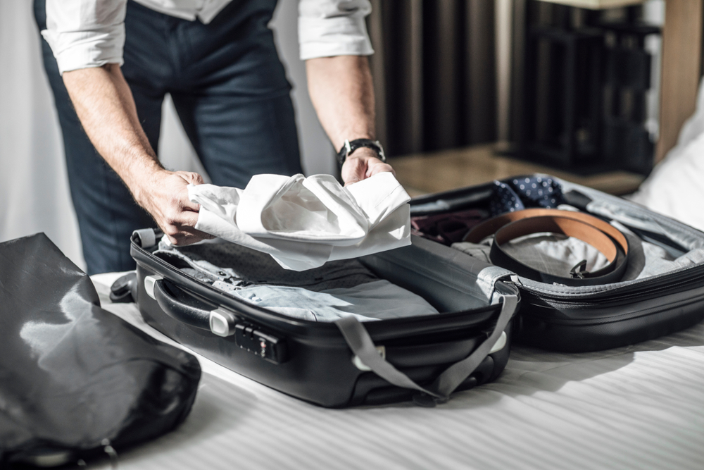 packing hacks for business travelers man packing