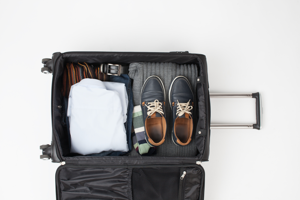 packing hacks for business travelers suitcase open