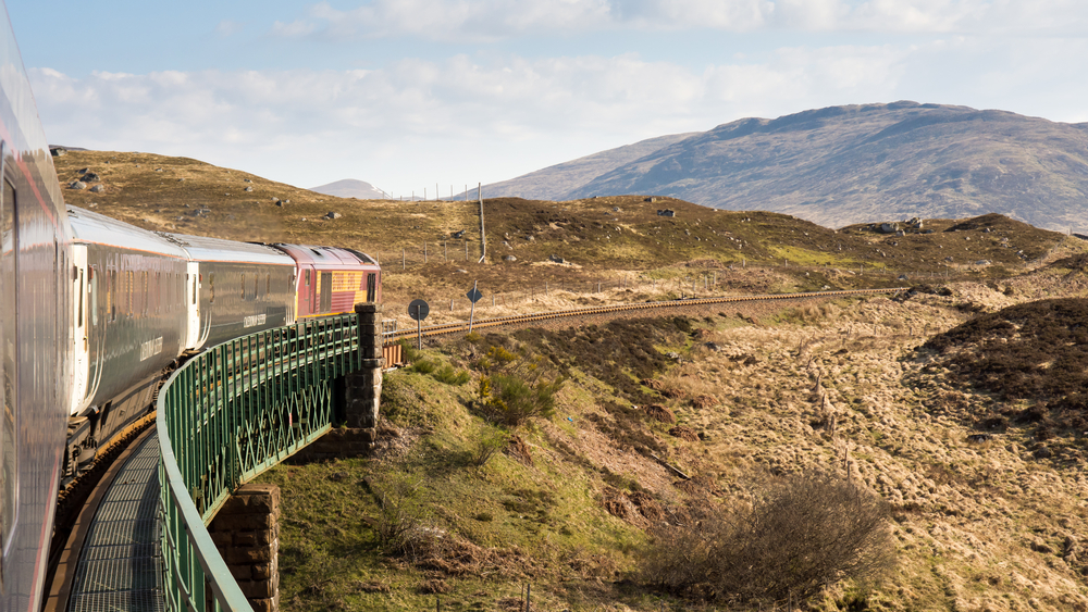 The Caledonian Sleeper train crosses Rannoch Viaduct on the scenic West Highland Line railway