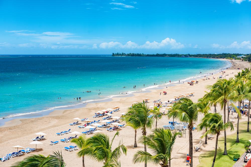 Puerto Rico beach travel vacation landscape background. Isla Verde resort in San Juan, famous tourist cruise ship destination in the Caribbean